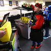 Devon Brown loads up his arms with the Grab and Go breakfast being offered at Bon Air Middle School on March 6, 2020.<br /> Tim Bath | Kokomo Tribune