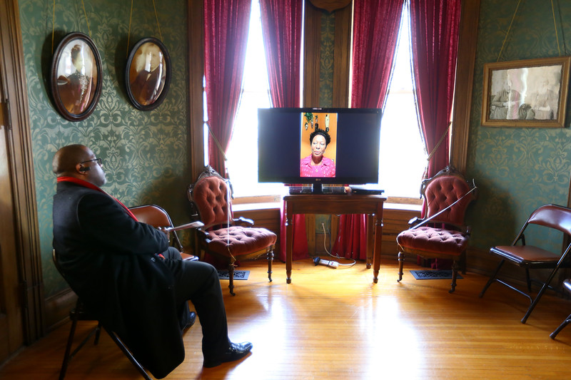Black Women in the Middle West open house at the Seiberling Mansion on Sunday March 15, 2020. Rev.William Smith watches a video recorded by the 1980s project coordinator Ruth Temoney talking about the project. Tim Bath | Kokomo Tribune