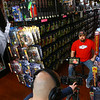 Mike Dukes films an interview with Kokomo Toys volunteer Jason Cowgill on April 18, 2020. Kokomo Toys & Collectibles will be featured on an Amazon Prime docuseries 'A Toy Store Near You,' which highlights toy stores across the world and how they've had to adapt during the coronavirus pandemic.<br /> Kelly Lafferty Gerber | Kokomo Tribune