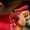 6-year-old Caroline Hunt helps her older sisters clean eggs in the mudroom on October 3, 2020.<br /> Kelly Lafferty Gerber | Kokomo Tribune