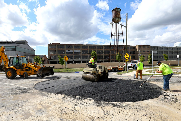 Kokomo Street Department employees Tim Wallace, Colton summers, Landon Matlock and Josh Clouthier pave the area where an island was removed at Home Ave and Apperson Way on Oct 1, 2020.<br /> Tim Bath | Kokomo Tribune