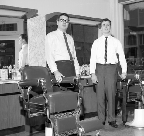 Walt Moss, left, and his brother and associate Dwayne Moss inside Walt Moss' Barber Shop in 1964.<br /> File photo