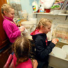 10-year-old Savannah Hunt, left, and her twin sister Lilly, along with their younger sister 6-year-old Caroline, clean eggs in the mudroom on October 3, 2020.<br /> Kelly Lafferty Gerber | Kokomo Tribune