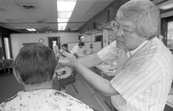Walt Moss cutting hair in 1992.<br /> File photo