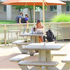 Campus life at IUK amid COVID-19 pandemic on Sept 1, 2020. Sitting alone outside the lunch room student Kathryn Peck is able to take her mask off.<br /> Tim Bath | Kokomo Tribune