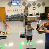 Violin teacher Sean Carey teaches both virtually and in person during his kindergarten violin class at Wallace Elementary School of Integrated Arts on Friday, September 4, 2020.<br /> Kelly Lafferty Gerber | Kokomo Tribune
