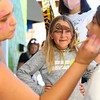 Mikaela Callaway, 7, watches as her friend Avery Wilson-Smith, 11, gets her face painted by Mad-e Zwiebel, of Shabby Beatnik, outside of Muse Underground during First Friday, on September 4, 2020.<br /> Kelly Lafferty Gerber | Kokomo Tribune