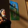"""Artist Ramona Daniels talks about her painting, """"Freedom,"""" during the grand opening of the new exhibit in Artist Alley, featuring 16 new pieces on display on First Friday, September 4, 2020 in downtown Kokomo.<br /> Kelly Lafferty Gerber 