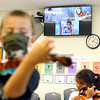 Kindergartners learn to play the violin virtually and in-person during Sean Carey's violin class at Wallace Elementary School of Integrated Arts on Friday, September 4, 2020.<br /> Kelly Lafferty Gerber | Kokomo Tribune