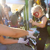 3-year-old Isaac helps his mom Karalyna Fivecoate tie-dye a shirt outside of Muse Underground during First Friday, on September 4, 2020.<br /> Kelly Lafferty Gerber | Kokomo Tribune