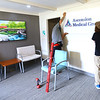 The City of Kokomo and Howard County employees new clinic on Sept 1, 2020, at 317 S. Berkley Road. Danny Hornady and Adam King hand one of the signs in the lobby.<br /> Tim Bath | Kokomo Tribune