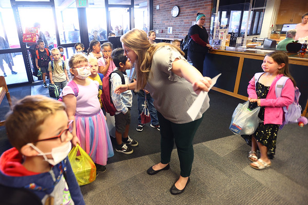 8-2-21<br /> Teacher Laura White directs students on the first day of school for Kokomo's Wallace Elementary School of Integrated Arts on Monday.<br /> Tim Bath   Kokomo Tribune