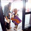 8-2-21<br /> Teacher Allison Keller lets kids in the front door on the first day of school for Kokomo's Wallace Elementary School of Integrated Arts on Monday.<br /> Tim Bath   Kokomo Tribune