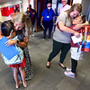 8-2-21<br /> Teahers Darcie York and Laura White hug returning students Victoria Zarate and Briseis Freeman on the first day of school for Kokomo's Wallace Elementary School of Integrated Arts on Monday.<br /> Tim Bath   Kokomo Tribune