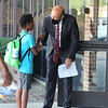 8-2-21<br /> Principal Jason Snyder greats student on the first day of school for Kokomo's Wallace Elementary School of Integrated Arts on Monday.<br /> Tim Bath   Kokomo Tribune