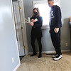 Wyman Group's Cassie Salinas going through a house on the south side of town with Alex Moore on Feb 3, 2021. They are looking at possible paint colors for one of the bedrooms.<br /> Tim Bath   Kokomo Tribune