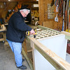 Stewart Worthley works on assembling the caterpillar house on Tuesday, February 2, 2021. The caterpillar house Worthley designed will be placed at Kokomo-Howard County Public Library's south branch this spring.<br /> Kelly Lafferty Gerber   Kokomo Tribune