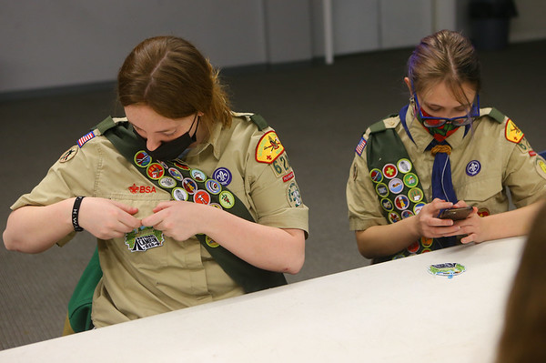 Jessica Shannon, left, checks out a new patch she received during Scout BSA Troop 628's meeting in Greentown on January 18, 2021.<br /> Kelly Lafferty Gerber | Kokomo Tribune