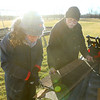 Lilly Shallenberger works alongside her grandfather Steve Skillington as Shallenberger resizes shingles to do roof work at the garden shed at Jerome Christian Church, Shallenberger's Eagle Scout project, on January 21, 2021. <br /> Kelly Lafferty Gerber | Kokomo Tribune