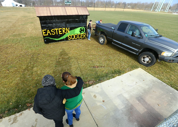 Scouts BSA Troop 628 leader Pat Skillington, along with Eagle Scout Jessica Shannon watch as Shannon's concession stand gets placed at Eastern's soccer fields on January 9, 2021. Designing and building the concession stand was Shannon's Eagle Scout project.<br /> Kelly Lafferty Gerber   Kokomo Tribune