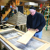 Stewart Worthley works on the door of the caterpillar house on Tuesday, February 2, 2021. The caterpillar house Worthley designed will be placed at Kokomo-Howard County Public Library's south branch this spring.<br /> Kelly Lafferty Gerber | Kokomo Tribune