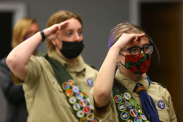 Abby Thatcher, right, and Jessica Shannon recite the Pledge of Allegiance prior to a Scouts BSA Troop 628 meeting in Greentown on January 18, 2021.<br /> Kelly Lafferty Gerber   Kokomo Tribune