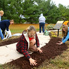 Abby Thatcher, center, works to mulch and replant flowers in the butterfly garden at Kokomo-Howard County Public Library's south branch on October 15, 2020. Helping with the butterfly garden was Thatcher's Eagle Scout project. <br /> Kelly Lafferty Gerber | Kokomo Tribune
