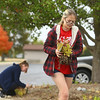 Abby Thatcher works on replanting flowers in the butterfly garden at Kokomo-Howard County Public Library's south branch on October 15, 2020. Working on the butterfly garden was Thatcher's Eagle Scout project.<br /> Kelly Lafferty Gerber | Kokomo Tribune