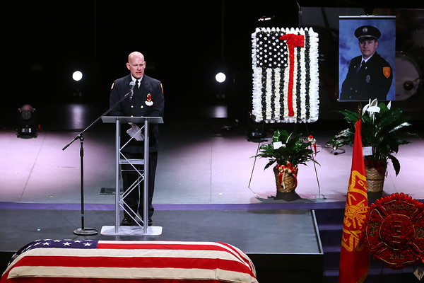 """3-9-21<br /> Chief Chris Frazier talks at Kokomo Firefighter Martin """"Marty"""" Meyers funeral with full honors at Crossroads Community Church after he died of COVID-19 while an active duty firefighter. <br /> Tim Bath 