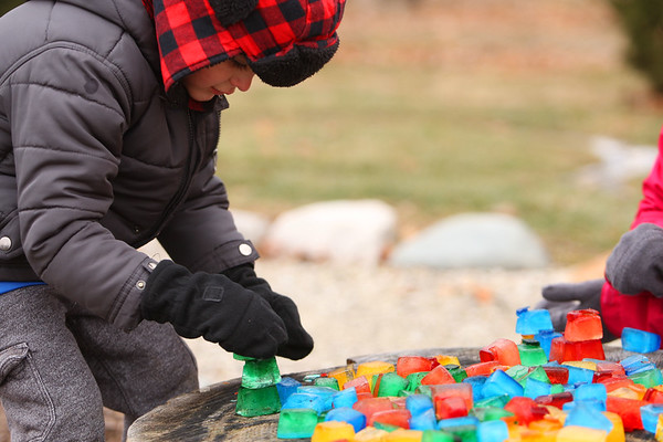 Gatlin Baker, 4, playing in the fun activities that include art and science in the form of outside play at the Russiaville library on Jan. 25, 2021.<br /> Tim Bath | Kokomo Tribune