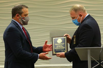 Mayor Tyler Moore is given the Distinguished Service Award by the State F.O.P. Vice President Toby Deaton for courage in supporting the Kokomo Police Department and giving them 20 percent raises on Jan. 4, 2021.  Tim Bath | Kokomo Tribune