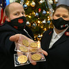 Lt. Joey Gates with his wife Lt. Pamela Gates holds 6 Krugerrand that were donated to the Salvation Army on Jan. 26, 2021.<br /> Tim Bath | Kokomo Tribune