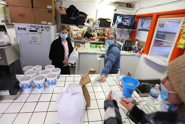 Kaylee Watson and Heather Rody bag and check orders for the car hops at Barker's B & K at 1100 East Markland on season opening day  on Tuesday Jan. 26, 2021.<br /> Tim Bath | Kokomo Tribune