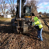Kokomo Street Department removes the railroad tracks from the area between Dixon and Markland Roads where the walking trails will extend toward Russiaville on Jan. 22, 2021. Dave Stout and Marc Mishler pick up plates and spikes from the old tracks.<br /> Tim Bath | Kokomo Tribune