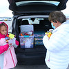 "Missy Gibson, right, and her granddaughter third grader Libby Anderson gather ducks in preparation to ""duck"" Jeeps in the Meijer parking lot on Tuesday, January 19, 2021."