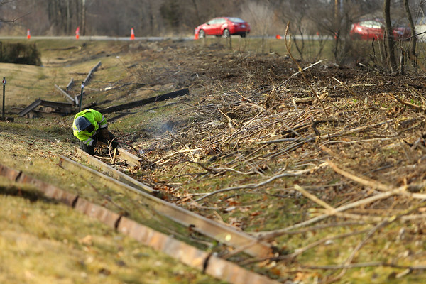Kokomo Street Department removes the railroad tracks from the area between Dixon and Markland Roads where the walking trails will extend toward Russiaville on Jan. 22, 2021. Landon Matlock uses an acetylene torch to cut the old rails into manageable size peices for transport to the recycler. <br /> Tim Bath | Kokomo Tribune