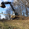 Kokomo Street Department removes the railroad tracks from the area between Dixon and Markland Roads where the walking trails will extend toward Russiaville on Jan. 22, 2021. Dave Stout lifts the rail pieces from the old bed.<br /> Tim Bath | Kokomo Tribune