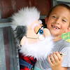 Mason Taylor, 7, smiles as he gives Granpa Cratchet a hug after a show at the Howard County 4-H Fair on July 14, 2021. Granpa Cratchet, created by puppeteer Sam Bowman from Sharpsville, has been entertaining kids and adults for the past 40 years.<br /> Kelly Lafferty Gerber | Kokomo Tribune