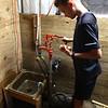7-14-21<br /> Bryan Schwartz cleaning eggs at Blue Barn Farm.<br /> Tim Bath   Kokomo Tribune