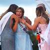 Keyton Romero, center, reacts after she is announced as Miss Howard County for 2021 and is congratulated by her court during the fair queen pageant on Tuesday, July 13, 2021 at the Howard County 4-H Fairgrounds.<br /> Kelly Lafferty Gerber   Kokomo Tribune