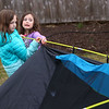 Sisters Coralee Komar, 8, and Madelyn Komar, 6, work together to put up a tent in their backyard, along with help from their mom Brooke Komar, on March 11, 2021 in preparation to sleep outside on March 12 for CAM's sleepout experience, to raise awareness of homelessness.<br /> Kelly Lafferty Gerber | Kokomo Tribune