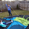 Brooke Komar, center, along with her daughters Coralee, left, and Madelyn, laugh as they work together to put up a tent in their backyard on March 11, 2021 in preparation to sleep outside on March 12 for CAM's sleepout experience, to raise awareness of homelessness.<br /> Kelly Lafferty Gerber | Kokomo Tribune