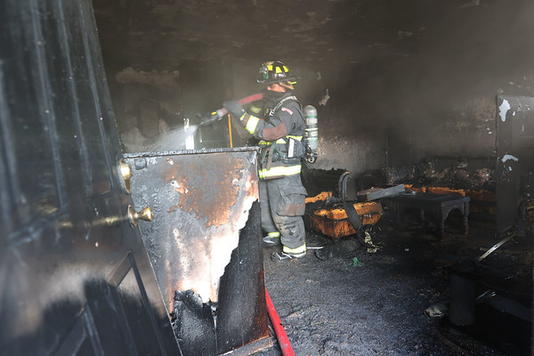 3-1-21<br /> Kokomo firefighters rescued the occupants during a house fire at 110 Versailles Ct on Monday. One of the occupants sustained serious burns.<br /> Tim Bath | Kokomo Tribune