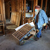 Glenn Fippen wheels out debris as he and other volunteers help clean up the future home of Tipton's no-kill animal shelter on Saturday, March 13, 2021.<br /> Kelly Lafferty Gerber | Kokomo Tribune