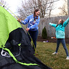 8-year-old Coralee Komar cheers as her mom Brooke Komar laughs as the two, along with Coralee's little sister Madelyn, finish putting up a tent in their backyard on March 11, 2021 in preparation to sleep outside on March 12 for CAM's sleepout experience, to raise awareness of homelessness.<br /> Kelly Lafferty Gerber | Kokomo Tribune