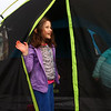 Madelyn Komar, 6, unzips the tent after she and her mom Brooke Komar, and sister Coralee put it up in their backyard on March 11, 2021 in preparation to sleep outside on March 12 for CAM's sleepout experience, to raise awareness of homelessness.<br /> Kelly Lafferty Gerber | Kokomo Tribune