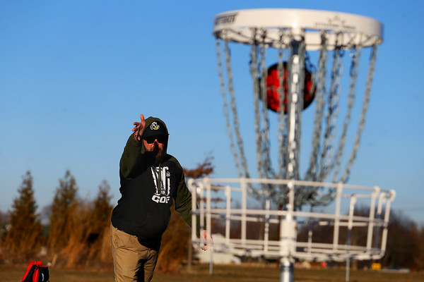 Tommy Ray plays a little disc golf at the new course behind the Stout Community Center in Russiaville on Jan. 26, 2021.<br /> Tim Bath   Kokomo Tribune