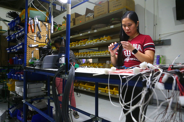 Lenita Carlile puts together a 16-pin harness at Green Cubes Technology's new facility at 2121 E. Boulevard on Wednesday, March 10, 2021.<br /> Kelly Lafferty Gerber | Kokomo Tribune