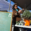 Susan Bednarz, Kokomo-Howard County Public Library's program specialist, makes lavender cuttings to give away at the Kokomo Downtown Farmers Market, which opened on Saturday, May 1, 2021 for its 20th season.<br /> Kelly Lafferty Gerber | Kokomo Tribune