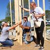 Volunteers Jill Hintz, Lester Hutchison, and Purdue student Rylan Grabis work together on Habitat for Humanity's new build on North Locke Street on Saturday, May 1, 2021.<br /> Kelly Lafferty Gerber | Kokomo Tribune